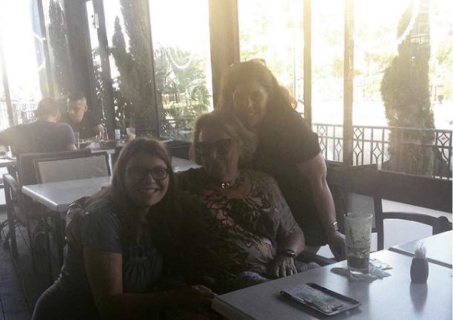 Julia poses with her Cousins Suzanne and Gabi at a restaurant in Israel.