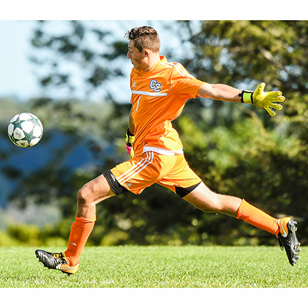 An action shot of men's soccer goalkeeper AJ Marcucci